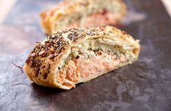 Salmon roulade. Slice of salmon roulade filled with salmon, herbs and cream cheese Stock Photos