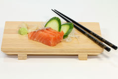 Salmon (Sake) Sushi. Japanese salmon sushi on bamboo tray with chopsticks and wasabi Royalty Free Stock Photography