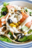 Salmon salad. Delicious salmon salad in restaurant Royalty Free Stock Photo
