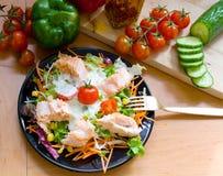 Salmon on salad Stock Photo
