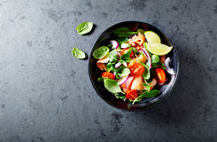 Salmon salad with baby spinach and corn salad Royalty Free Stock Image