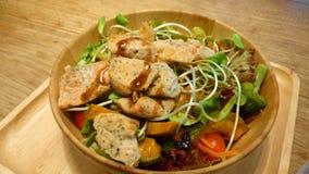 Salmon salad bowl. Salmon salad healthy food in wood bowl on wood table Royalty Free Stock Photos