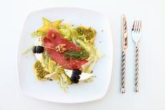 Salmon salad and cutlery Stock Image