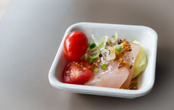 Salmon salad. In the disk Stock Photos