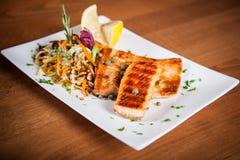 Salmon with salad. Salmon filet with vegetables salad Stock Photos