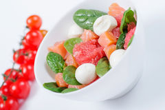 Salmon salad with grapefruit, spinach and mozzarella. With cherry tomatoes. Olive oil dressing Royalty Free Stock Photo