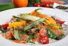 Salmon salad with orange Royalty Free Stock Photo