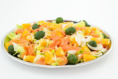 Salmon salad and pieces of orange Stock Photography