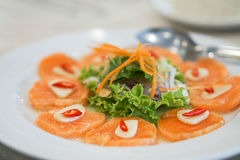 Salmon salad. Spicy sour raw salmon salad Royalty Free Stock Image