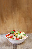 Salmon salad on wooden table Royalty Free Stock Images