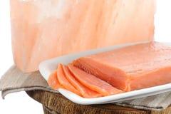Salmon salted with pink salt block. Salmon salted with Hymalaya pink salt block Royalty Free Stock Image