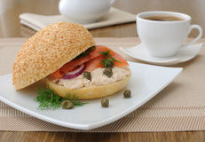 Salmon sandwich and a cup of coffee Royalty Free Stock Photo