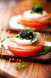 Salmon Sandwich with Egg and Caviar Royalty Free Stock Photos