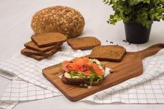 Salmon Sandwich. On wooden plate Stock Image