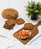 Salmon Sandwich. On wooden plate Stock Images