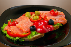 Salmon sandwich. Sandwiches with salmon salad decorated with vegetables and herbs Royalty Free Stock Photography