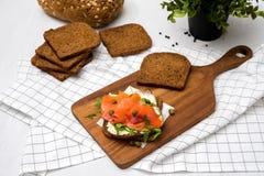 Salmon Sandwich. On wooden plate Stock Photo