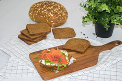 Salmon Sandwich. On wooden plate Royalty Free Stock Image