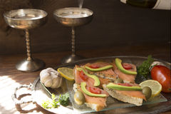 Salmon sandwiches and the champagne Royalty Free Stock Photo