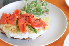 Salmon sanwich or baguette with salmon and vegetable. Topping Stock Photo