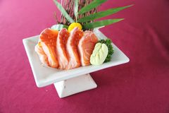 Salmon sashimi set on a plate. In close up royalty free stock image