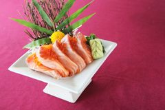Salmon sashimi set on a plate. In close up stock photography