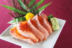 Salmon sashimi set on a plate. In close up royalty free stock photo
