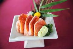 Salmon sashimi set on a plate. In close up stock photos