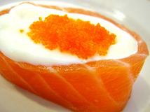 Salmon sashimi. Fish eggs with rice surrounded by Salmon fish meat royalty free stock images
