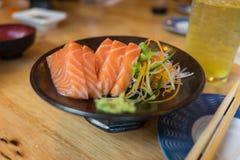 Salmon Sashimi on Black Ceramic Plate Stock Images