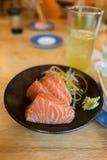 Salmon Sashimi on Black Ceramic Plate Royalty Free Stock Photo