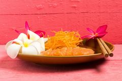 Salmon sashimi on dish with flower on wood color pink.  stock photos