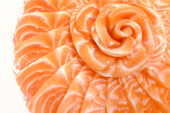 Salmon sashimi on flower shape on ice bowl boat on white isolated background. Closeup of sashimi salmon for background, Shoot this picture from restaurant Royalty Free Stock Photography