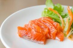 Salmon sashimi with fresh salad Royalty Free Stock Photos
