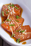 Salmon sashimi with ginger and sesame Royalty Free Stock Photos