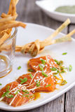 Salmon sashimi with ginger and sesame Stock Images