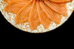 Salmon sashimi grill flower shape on circle plate on black background. Closeup photo of Salmon sashimi, shoot in japanese restaurant Royalty Free Stock Photography