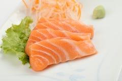 Salmon sashimi on a plate, Japanese food. Salmon sashimi on a plate in close up, Japanese food royalty free stock image