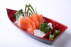 Salmon Sashimi in red boat bowl isolated on white background Royalty Free Stock Images