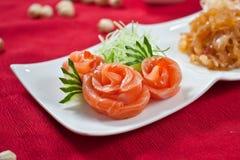 Salmon Sashimi. Rolled thin slices of salmon sashimi on a plate royalty free stock images