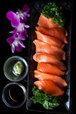 Salmon sashimi. Served with soy sauce and wasabi stock photo