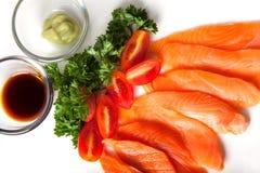 Salmon sashimi. Served with soy sauce and wasabi stock photos