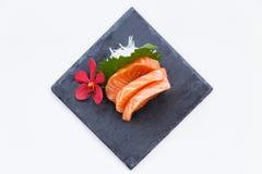 Salmon Sashimi : Sliced Raw Salmon Served with Sliced Radish on Stone Plate.  Stock Photography
