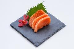 Salmon Sashimi : Sliced Raw Salmon Served with Sliced Radish on Stone Plate.  Royalty Free Stock Photography