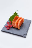 Salmon Sashimi : Sliced Raw Salmon Served with Sliced Radish on Stone Plate.  Stock Photos