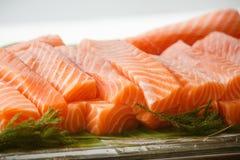 Salmon sashimi. Some salmon sashimi in a glass box wait for eat stock photos