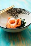 Salmon sashimi with soy sauce and wakame Stock Images