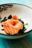 Salmon sashimi with soy sauce and wakame Stock Image