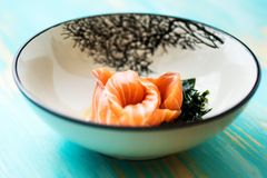 Salmon sashimi with soy sauce and wakame Royalty Free Stock Photos