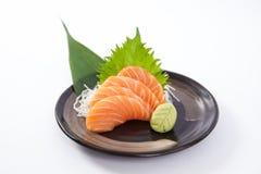 Salmon Sashimi. Thin slices of salmon sashimi on a plate stock photos